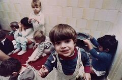 Romanian orphans play without toys at Bucharest's Number one Orphanage in Bucharest, Romania, February 14, 1991. After the Iron Curtain was torn down almost 25 years ago, childless western couples flooded into Romania looking to adopt. THE CANADIAN PRESS/AP, Siumui Chan