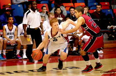 Sturgeon Heights Huskie Matt Jonsson and Kildonan East Reivers Ashdeep GIll flail over the ball at the Wesmen Classic.