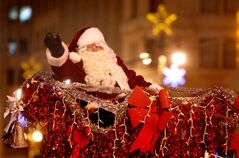 Santa waves from sleigh on Portage Avenue during the Santa Claus Parade.
