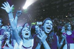 Fans react as musician Justin Bieber performs during the Believe Tour at Staples Center in Los Angeles.