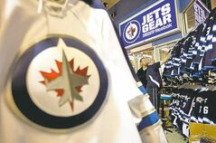 Staff at the Winnipeg Jets gear merchandise store at the MTS Centre help customers get their pre-ordered jerseys  Saturday, Oct. 8, 2011.  The Jets will play the Montreal Canadiens in their inaugural game on Sunday. THE CANADIAN PRESS/Jonathan Hayward