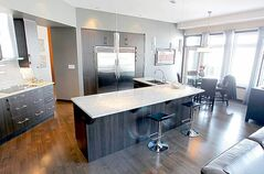 'The granite island was angled to open up room in and around the kitchen, and the dinette area is in an extra-large space next to three windows and a deck door. You get the best of both worlds -- the lake view and room to move,' says KDR Homes' Diego Vassallo.