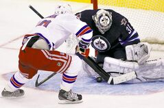 NO GOAL: Jets goaltender Ondrej Pavelec stops Rangers forward Marian Gaborik after he fumbled a penalty shot in the first period Thursday night.