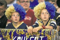 The faces of two young Bombers fans Friday seem to sum up the season so far.
