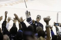 Winnipeg Jets goaltender Ondrej Pavelec (31) tosses his game stick into the stands on Saturday.
