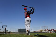 Cleveland Indians' Michael Brantley swings during spring training baseball practice, Monday, Feb. 17, 2014, in Goodyear, Ariz. (AP Photo/Paul Sancya)