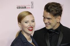 FILE - In this Feb. 28, 2014 file photo, U.S. actress Scarlett Johansson, left, and her partner Romain Dauriac arrive at the 39th French Cesar Awards Ceremony, in Paris. Johansson is a first-time mom. A spokesman for the 29-year-old actress said Thursday, Sept. 4, 2014, that Johansson and her fiance, Dauriac, have welcomed a baby girl, whom they've named Rose. (AP Photo/Lionel Cironneau, file)