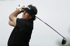 Phil Mickelson watches his tee shot on the second hole of the South Course during the second round of the Farmers Insurance Open golf tournament Friday, Jan. 24, 2014, in San Diego. (AP Photo/Gregory Bull)