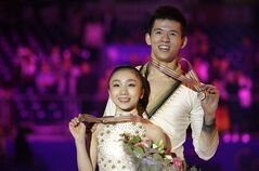 Japan pairs Narumi Takahashi and Mervin Tran, pose with their bronze medal, on the podium of pairs at the 2012 World Figure skating Championships in Nice, southern France, Friday, March 30, 2012. Canadian figure skater Mervin Tran is considering changing his nationality in order to compete for Japan at the 2014 Sochi Winter Olympics. THE CANADIAN PRESS/AP-Lionel Cironneau