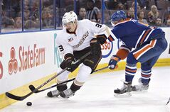 Anaheim Ducks' Jakob Silfverberg (33) is chased by Edmonton Oilers' Mark Fraser (5) during first period NHL hockey action in Edmonton, on Sunday April 6, 2014. The Anaheim Ducks have re-signed forward Jakob Silfverberg to a one-year, $850,500 contract. THE CANADIAN PRESS/Jason Franson