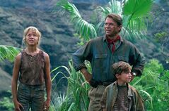 Ariana Richards (left to right) Sam Neil and Joseph Mazzello are shown in a scene from the 1993 film Jurassic Park. Ariana Richards still enjoys returning to the