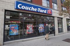 A man passes by a Couche Tard convenience store in Montreal, on October 5, 2012. THE CANADIAN PRESS/Graham Hughes.