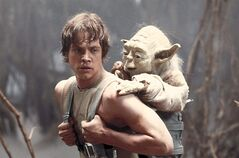 Mark Hamill as Luke Skywalker and the character Yoda appear in this scene from