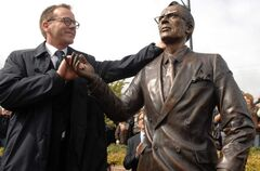 A statue of Tommy Douglas, the father of health care, with his grandson, Canadian actor Keifer Sutherland.