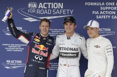 Mercedes driver Nico Rosberg of Germany is flanked by second placed Red Bull driver Sebastian Vettel of Germany, left, and third placed Williams driver Valtteri Bottas of Finland after he clocked the fastest time during the qualifying of the Hungarian Formula One Grand Prix in Budapest, Hungary, Saturday, July 26, 2014. The Hungarian Grand Prix will be held on Sunday, July 27, 2014. (AP Photo/Petr David Josek)