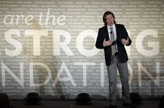 Livestrong Foundation's executive vice president Andy Miller speaks at its annual meeting Thursday, Feb. 28, 2013, in Chicago. Leaders of the cancer charity founded by Lance Armstrong said at the first such gathering since Armstrong was engulfed in scandal that the organization will persevere in the wake of the cyclist's admission that he used performance-enhancing drugs. (AP Photo/Kiichiro Sato)