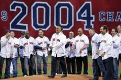 Former Boston Red Sox's Manny Ramirez, middle, laughs with teammates from 2004 after throwing a ceremonial first pitch at Fenway Park prior to a baseball game against the Atlanta Braves in Boston, Wednesday, May 28, 2014. The Red Sox honored the 2004 World Series team prior to the game. (AP Photo/Elise Amendola)