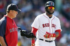 Boston Red Sox manager John Farrell, left, walks to first base with David Ortiz after Ortiz was hit by a pitch during the sixth inning of a baseball game against the Seattle Mariners in Boston, Saturday, Aug. 23, 2014. (AP Photo/Michael Dwyer)
