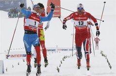 Nikita Kriukov of Russia (1) reacts as he crosses the finish line to win the men's 1.5 km classic sprint of the Nordic Ski World Championships in Val di Fiemme, Italy, Thursday, Feb. 21, 2013. At right is second placed Petter Northug of Norway. (AP Photo/Armando Trovati)
