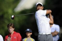 Tiger Woods watches his tee shot on the third hole during the Pro-Am at the Quicken Loans National golf tournament, Wednesday, June 25, 2014, in Bethesda, Md. (AP Photo/Nick Wass)