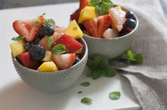 This June 9, 2014 photo shows black pepper and honey fruit salad in Concord, N.H. The combination of honey and black pepper can give fruit salad some zing. (AP Photo/Matthew Mead)