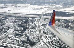 In this Wednesday, Jan. 8, 2014, photo, a Southwest plane approaches Lambert–St. Louis International Airport in St. Louis. Southwest Airlines Co. is expanding beyond the continental United States with flights to the Caribbean beginning July 1. (AP Photo/Kiichiro Sato)