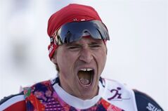 Norway's Ola Vigen Hattestad celebrates winning the gold after winning the men's final of the cross-country sprint at the 2014 Winter Olympics, Tuesday, Feb. 11, 2014, in Krasnaya Polyana, Russia. (AP Photo/Matthias Schrader)