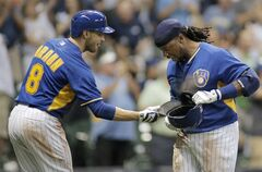 Milwaukee Brewers' Rickie Weeks, right, is congratulated by Ryan Braun, left, after hitting a three run home run against the Los Angeles Dodgers during the eighth inning of a baseball game Friday, Aug. 8, 2014, in Milwaukee. (AP Photo/Darren Hauck)