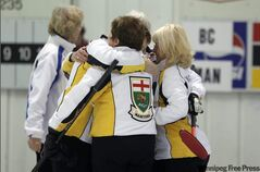 Lead Karen Dunbar, left, gives skip Joyce McDougall a hug after the Brandon foursome captured the Canadian Masters Women's Curling Championship Tuesday.