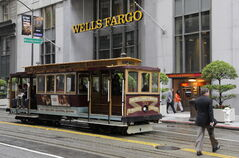 A California Street cable car travels past the headquarters of Wells Fargo & Co., in San Francisco.