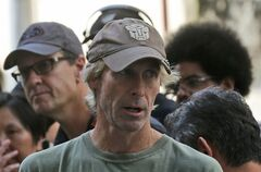American film director Michael Bay speaks with his film crew during the filming of a scene for their latest movie
