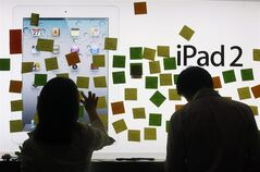 Fans leave condolent notes to pay tribute to Apple founder and former CEO Steve Jobs at an Apple retail store in Hong Kong Thursday, Oct. 6, 2011. Jobs, the co-founder of Apple Inc. and father of the iPhone, has died at age 56. (AP Photo/Kin Cheung)