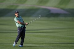 Edoardo Molinari of Italy follows his ball on the first hole during the second round of the Dubai Desert Classic golf tournament in Dubai, United Arab Emirates, Friday, Jan. 31, 2014. (AP Photo/Kamran Jebreili)
