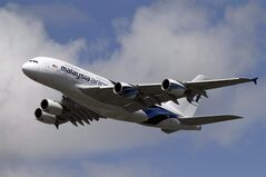 A Malaysian Airlines System (MAS) Airbus A380 performs an aerial display in Farnborough, England, July 11, 2012. THE CANADIAN PRESS/AP, Lefteris Pitarakis