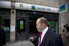 People pass a branch of Lloyds TSB on High Holborn in London, on July 19, 2012. THE CANADIAN PRESS/AP, Matt Dunham