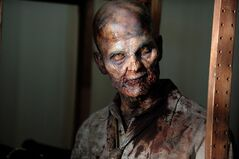 This AMC photo shows a zombie in a scene from