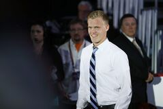 Nikolaj Ehlers walks to the stage after being chosen ninth overall by the Winnipeg Jets during the first round of the NHL hockey draft, Friday, June 27, 2014, in Philadelphia. (AP Photo/Matt Slocum)