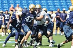 Winnipeg Blue Bomber linebacker Pierre-Luc Labbe looks for an opening in the O-line during practice at Canad Inns Stadium Monday.