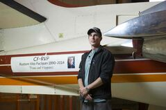 Instructor Leon Woychuk with a plane renamed for Rustom Paclipan.