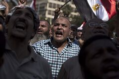 An Egyptian man chants slogans supporting Egypt's Islamist President Mohammed Morsi during a rally near Cairo University in Giza, Egypt, Tuesday, July 2, 2013. THE CANADIAN PRESS/AP, Manu Brabo