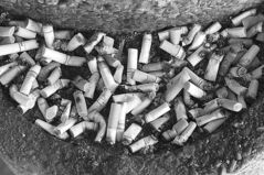 JOE.BRYKSA@FREEPRESS.MB.CA Local- ( For file)-Cigarette butts over flow from a outside ashtray in front of a downtown Winnipeg hotel - JOE BRYKSA/WINNIPEG FREE PRESS- Feb 15, 2010