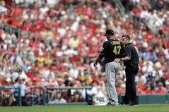 Pittsburgh Pirates starting pitcher Francisco Liriano walks off the field with a trainer while leaving a baseball game against the St. Louis Cardinals during the third inning Saturday, April 26, 2014, in St. Louis. (AP Photo/Jeff Roberson)