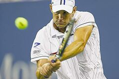 Andy Roddick returns a shot to Australia's Bernard Tomic Friday night.