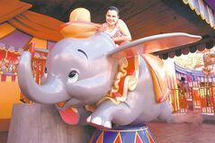 Grace MacNaull hams it up on the expanded Dumbo the Flying Elephant ride at New Fantasyland.