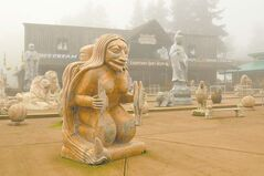 Massive stone carvings from China guard the entrance to the Coombs Emporium on central Vancouver Island.