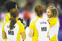 Manitoba skip Jennifer Jones enjoys a chuckle with her teammates during a break in play against New Brunswick during the 16th draw at the Scotties on Friday in Kingston, Ont.