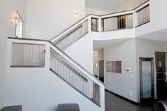 Head upstairs via a stylish, flared tricolour staircase (espresso maple trim/capping, stainless steel spindles and beige-trimmed walls with cutouts that show off the spindles) and the emphasis is squarely on livability and luxury.
