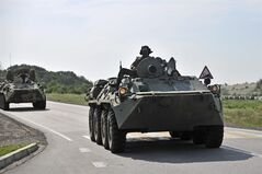 Two Russian armored personal carriers roll near the border with Ukraine outside the Russian town of Donetsk in Rostov-on-Don region, Sunday, July 13, 2014. THE CANADIAN PRESS/AP, Sergei Pivovarov