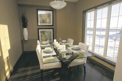 A dining room is bright with a lovely view.