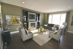 The maple entertainment unit and gas fireplace are optional in the family room.